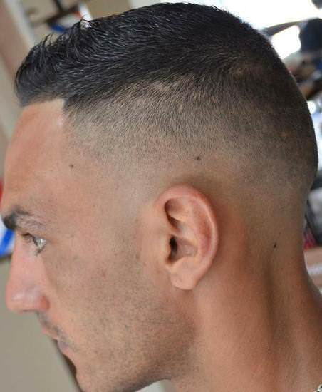 Dark high and tight sporty haircuts for men
