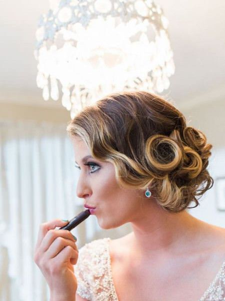 Low updo with pin curls mid-length hairstyles