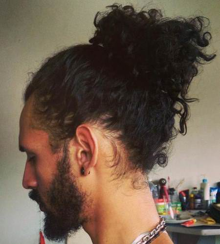 curly ponytail long hairstyles for men