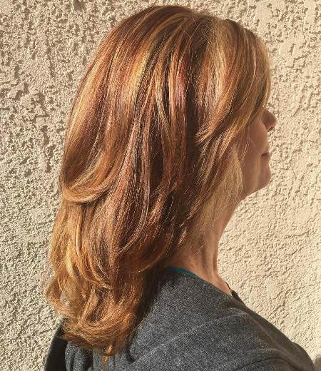 golden and red layered hairstyles for women over 40
