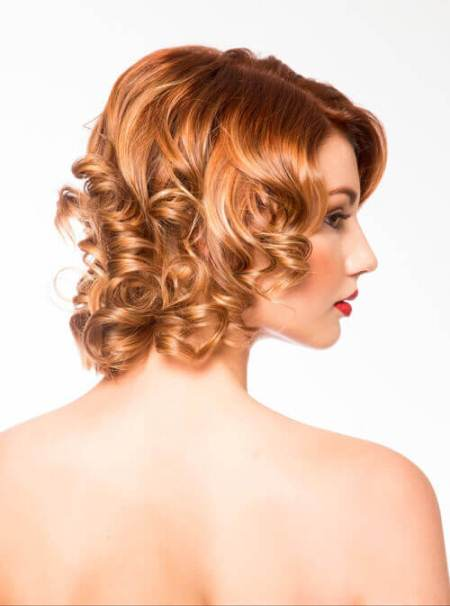 loose copper curls with side bangs short hairstyles for round faces