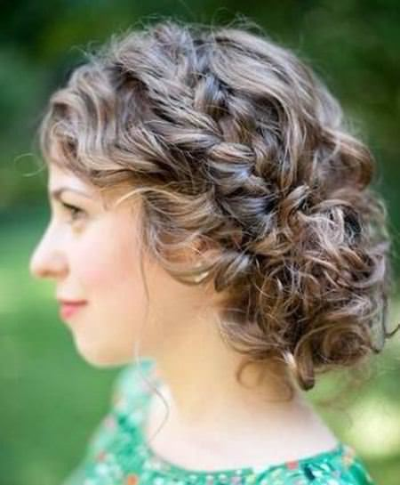 medium curly updo with a braid mid-length hairstyles