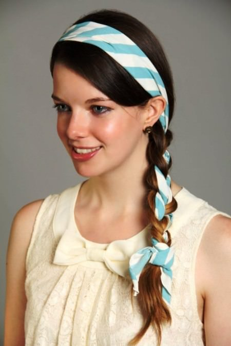side braid with a scarf headband mid-length hairstyles