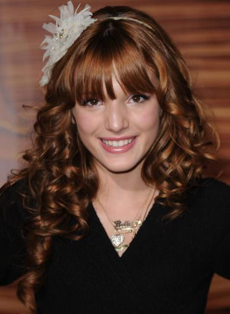spiral curls with even fringes curly hairstyles for girls