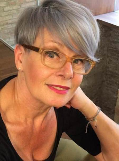 Cropped gray with swooped bangs hairstyles for older women