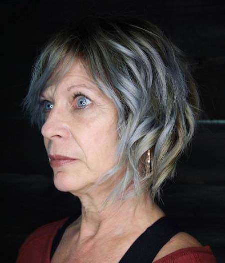 Silver side swoop hairstyles for older women