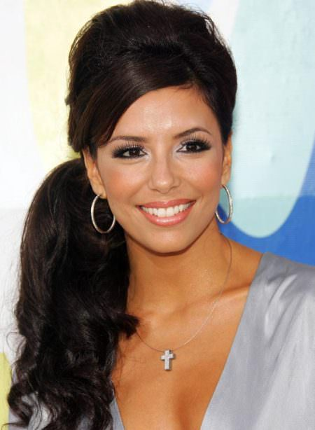 Wavy-Side-Ponytail-with-Puffy-Crown-and-Side-Swept-Bang black ponytail hairstyles