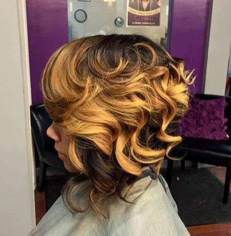 golden blonde balayage curls inverted bob haircut