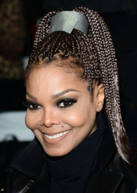 high braided ponytail with acessory black ponytail hairstyles