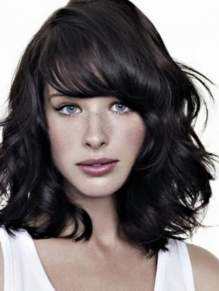 layered medium wavy hairstyles for thick hair
