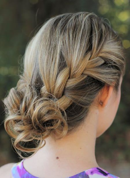 side curly bun with a side braid hairstyles for short hair