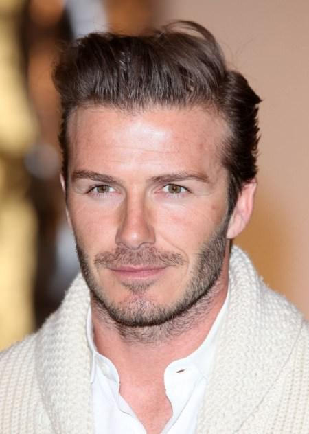 Effortless Slicked Back Men's Hairstyle man with the millon faces
