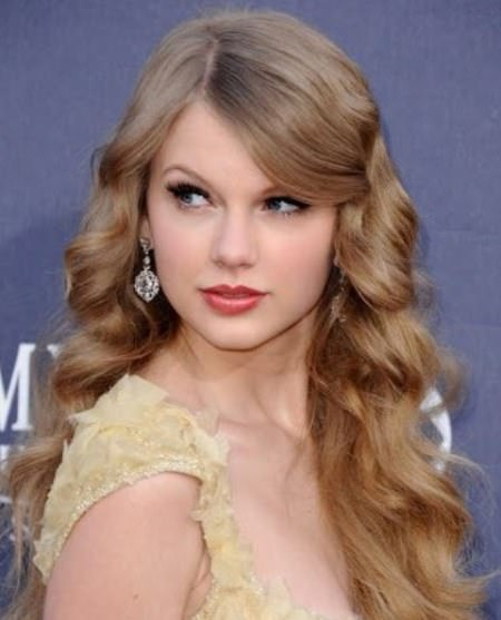 Long loose curls with voluminous curls with bangs long haircuts for women