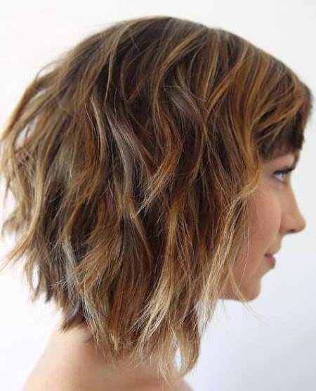 Wavy collarbone lob with choppy bangs choppy bob hairstyles