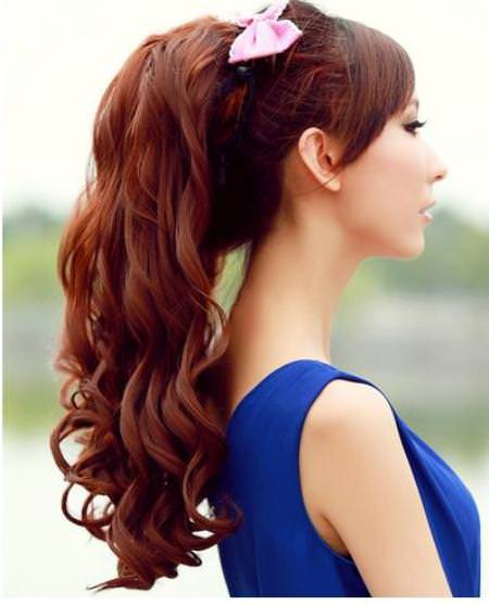 casual wavy ponytails with a bow