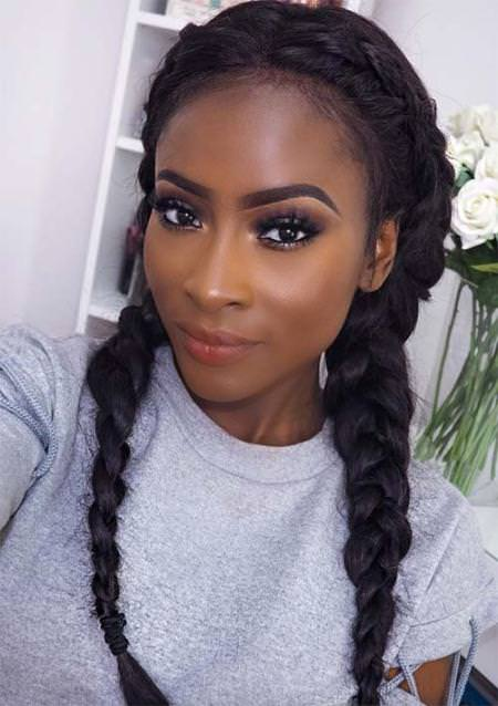 center parted crown into fishtail braid natural braided hairstyles