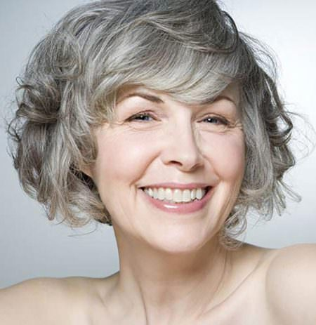 curly bob with side swept bangs hairstyles for gray hair