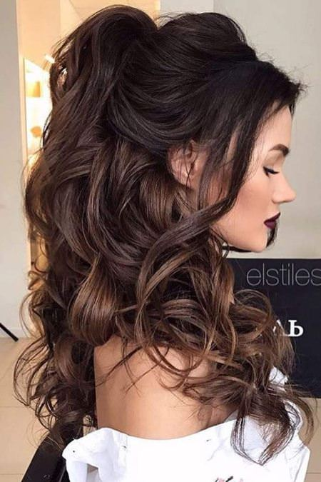 curly half ponytails with bangs