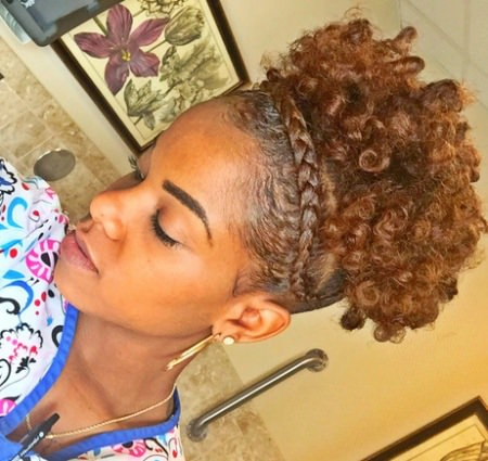 curly updo with a crown braid hairstyles for long natural hair