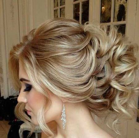 curly updo with puffy top and loose strands bridal hairstyles