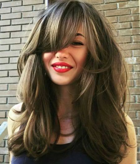 long layered hairstyle with side swept bangs hairstyles for long thick hair