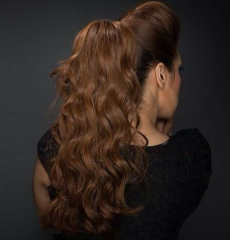 long wavy ponytails with a high bouffant