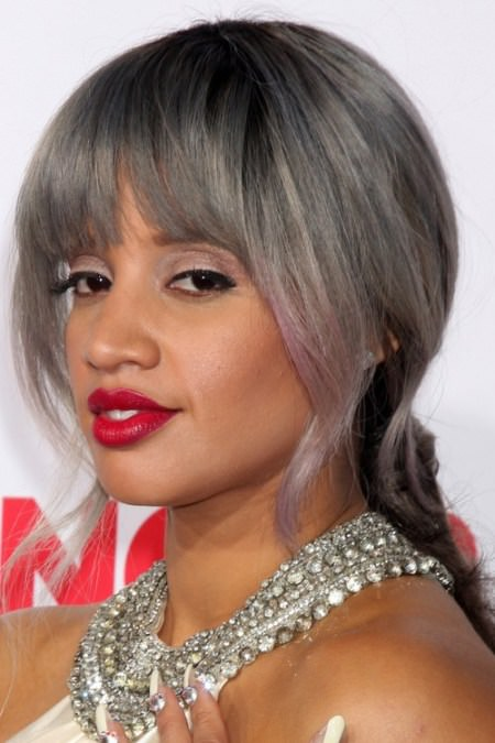 low silvered ponytail hairstyle with forehead bangs Black Hairstyles with Bangs