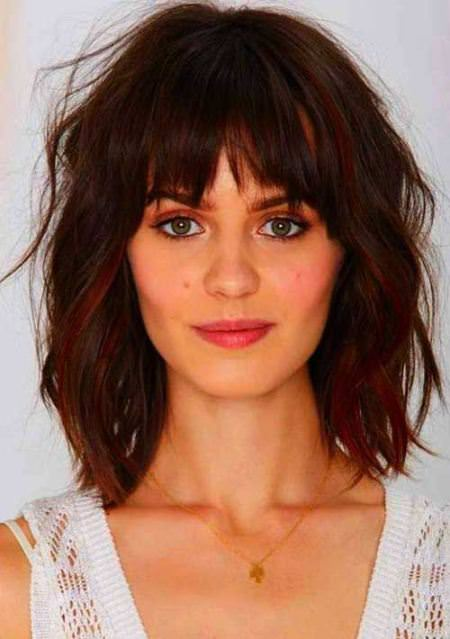 messy horizontal bangs for round faces