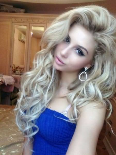 messy voluminous long hair with curls and texture bridal hairstyles