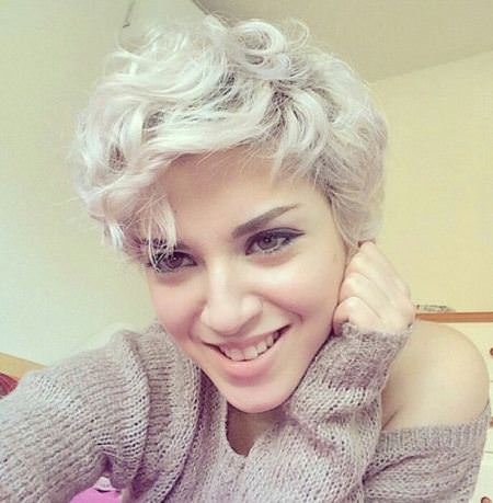 platinum blonde pixie with side bangs wavy pixie cuts