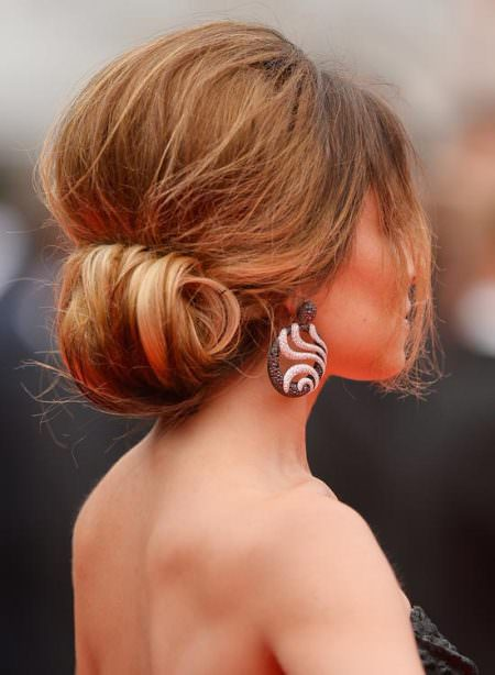 rolled updo with puff crown and side bangs short hair buns