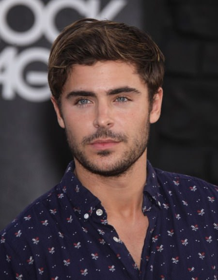 short disheveled hairstyle with a swept up quaff Zac Efron Hairstyles