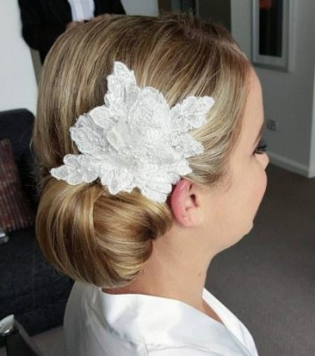 side bun with floral hair accessory side bun hairstyles