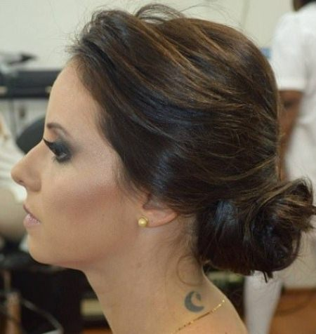 side bun with up swept bangs side bun hairstyles