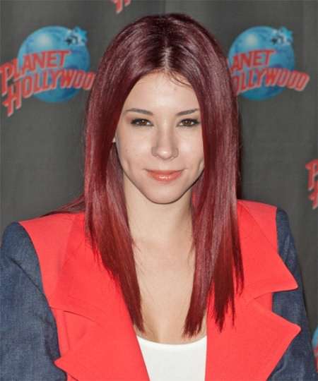 sleek and straight red hair with a middle part long red hairstyles