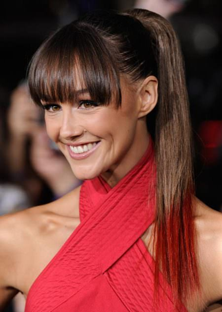 sleek high ponytails with bangs