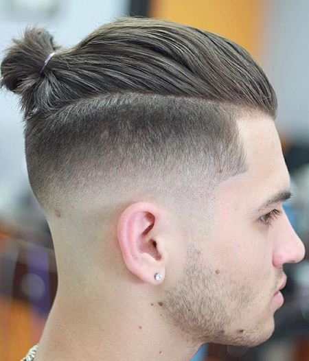 tapered fade with bun hairstyles for balding men