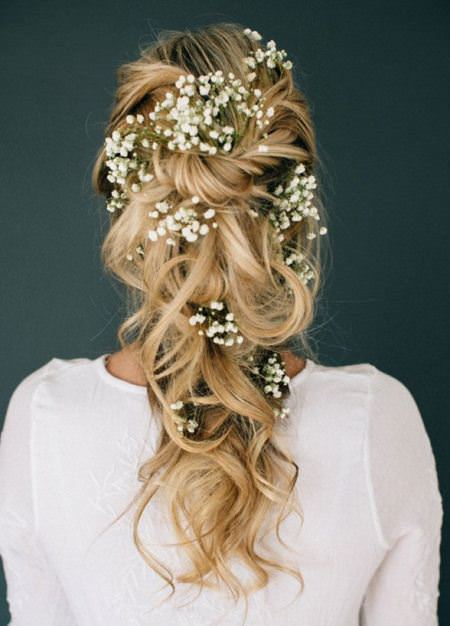 textured ponytail with twisted and pinned hair bridal hairstyles