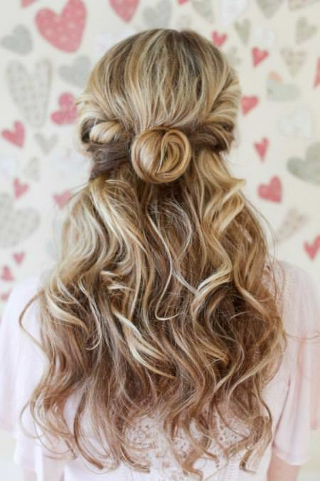 twisted half bun with curly waves bridal hairstyles