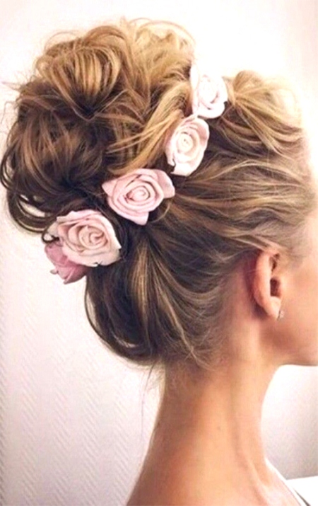 twisted high bun with flowers bridal hairstyles
