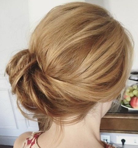 twisted up side bun side bun hairstyles