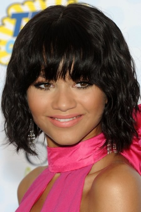 wavy black bob with arched bangs Black Hairstyles with Bangs