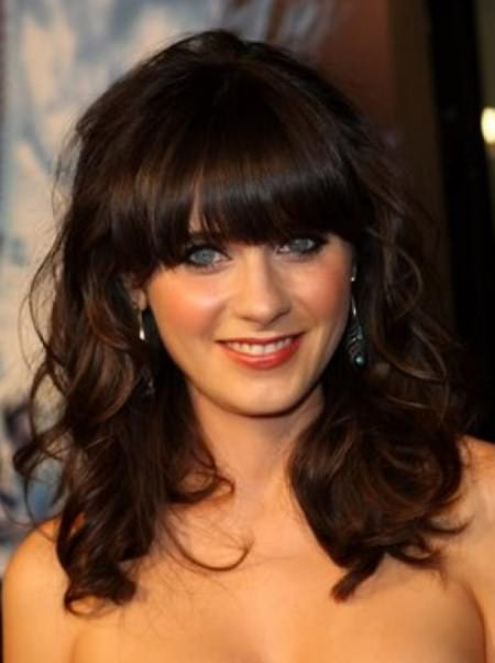 wavy hair with straight bangs for round faces