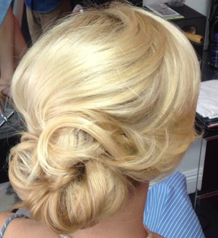 wispy and whimsical chignon buns