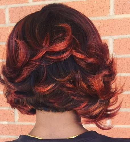 Layered weave with bright highlights weave hairstyles for black women