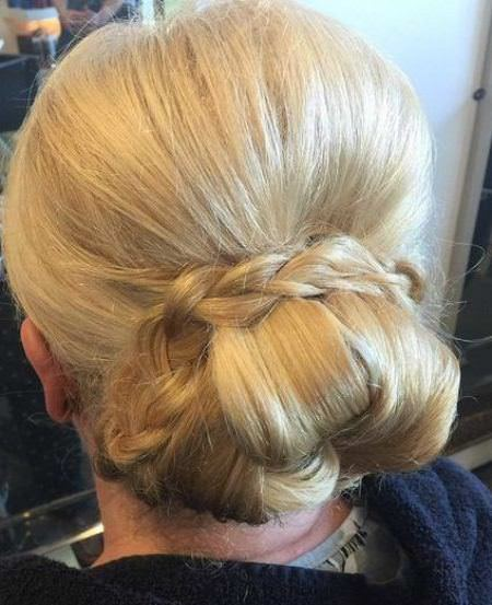 Low bun with encircling updos for women over 40