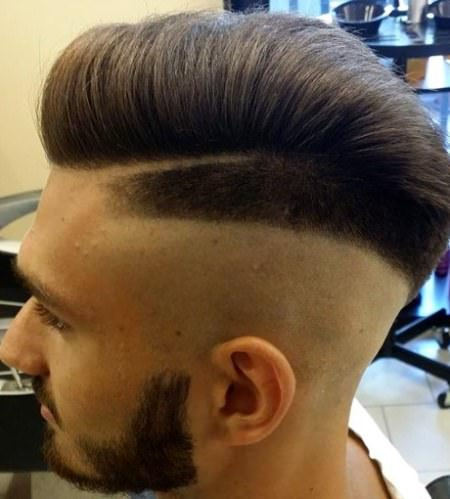 Sharp skin fade with neat combover mohawk hairstyles for men