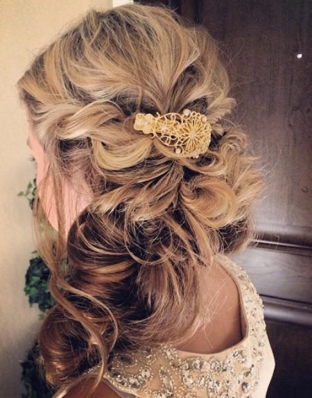 curled clipped to the sidehalf up and half down wedding hairstyles