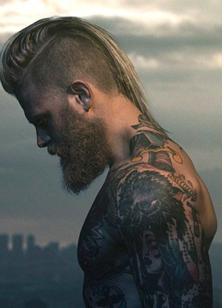 long hair, full beard and shaved side mohawk hairstyles for men