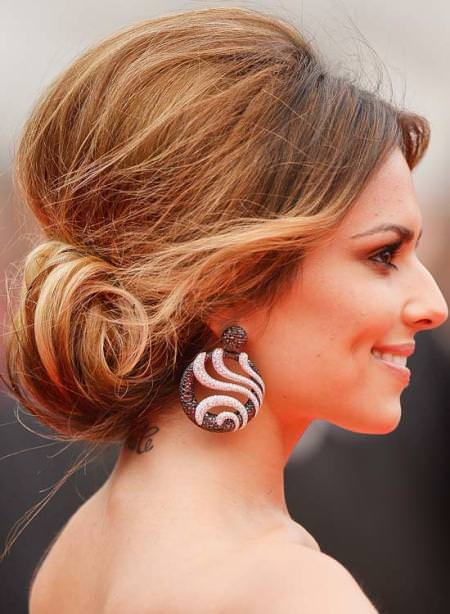 low bun with a mini bouffant and side sweep ideas for brides